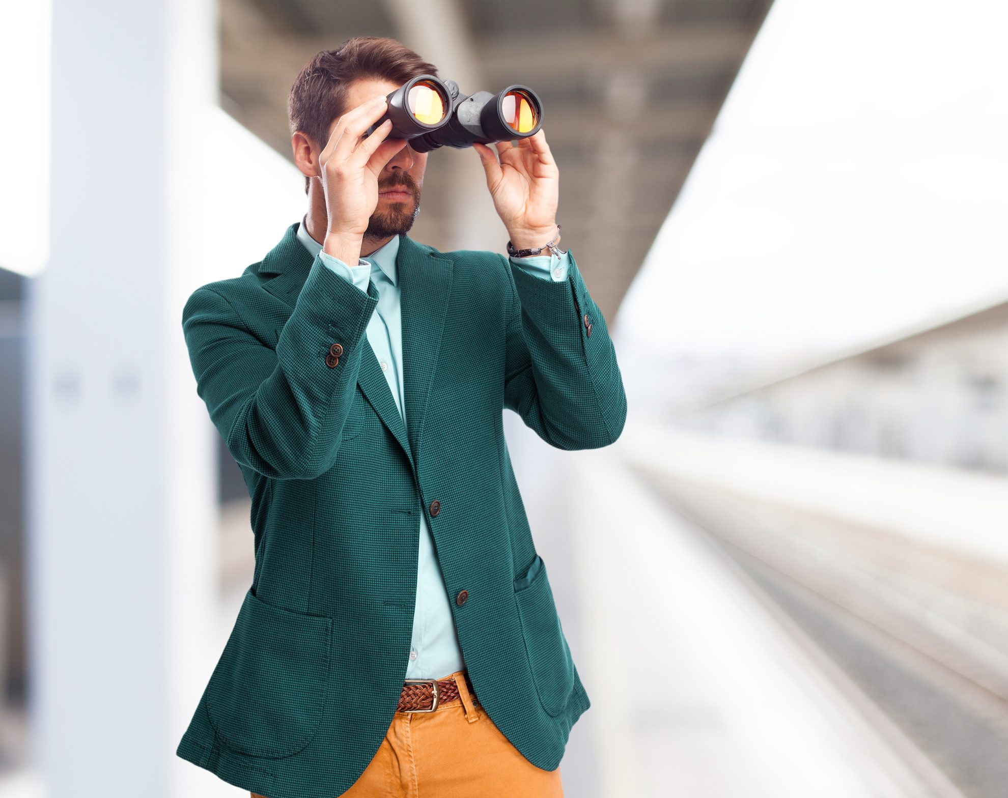 businessman looking for with binoculars